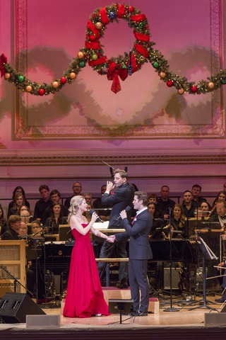 "Kelli O'Hara, maestro Steven Reineke and Matthew Morrison with the New York Pops and Essential Voices USA in ""Home for the Holidays"" (Photo credit: Richard Termine)"