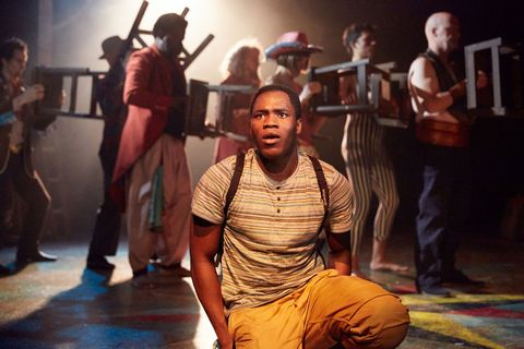 "Martins Imhangbe as Charlie Ashanti in a scene from Complicite's ""Lionboy"" (Photo credit: Mark Douet)"