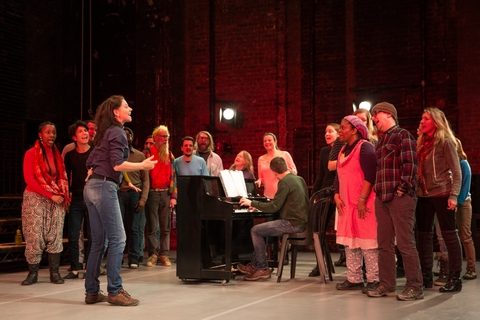 """Neve McIntosh and choir in a scene from """"The Events"""" (Photo credit: Matthew Murphy)"""