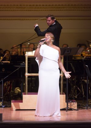 """Queen Latifah as she sang """"When You're Good to Mama"""" from """"Chicago"""" with Maestro Steven Reineke at The New York Pops 32nd Birthday Gala (Photo credit: Richard Termine)"""