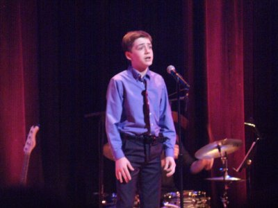 "Ninth grader Mercer Patterson as he sang """"Mama, A Rainbow"" from ""Minnie's Boys"" (Photo credit: Maryann Lopinto)"