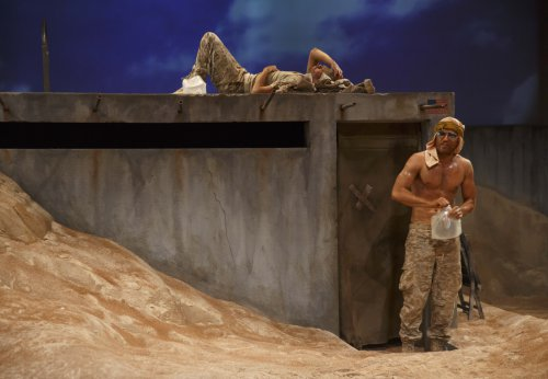 "Brian Miskell and Seth Numrich in a scene from ""Afghanistan, Zimbabwe, America, Kuwait"" (Photo credit: Joan Marcus)"