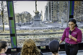 The Tour's guide Rory Lipede as she describes Columbus Circle