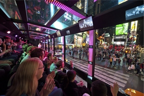 The Tour as it passes by the crowds at Duffy Square and 46th Street