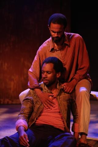"Joshua David Robinson (on ground) and Danyon Davis (above) in a scene from Ken Urban's ""Sense of an Ending"" (Photo credit: Carol Rosegg)"