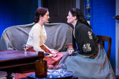 "Helen Cespedes and Heather Hollingswoth in a scene from ""Couriers and Contrabands"" (Photo credit: Al Foote III)"