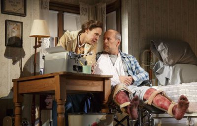 """Laurie Metcalf as Annie Wilkes and Bruce Willis as Paul Sheldon in a scene from """"Misery"""" at the Broadhurst Theatre (Photo credit: Joan Marcus)"""