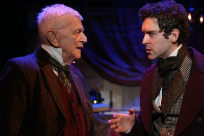 "Robert Stattel as Scrooge and Nathan Gardner as Timothy in a scene from ""The Astonishing Times of Timothy Cratchit"" (Photo credit: Gerry Goodstein)"