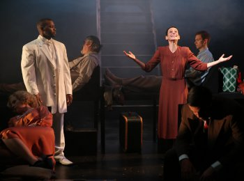 """Lamar Giles (white suit) and Giselle Wolf as the Insane Woman in a scene from Thornton Wilder's """"Pullman Car Hiawatha"""" (Photo credit: Carol Rosegg)"""