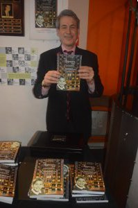 "Writer Michael Colby with copies his memoir, ""The Algonquin Kid"" (Photos by Maryann Lopinto)"