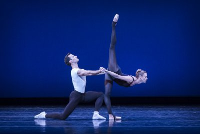 """Pacific Northwest Ballet's soloists Jerome Tisserand and Lesley Rauch in Balanchine's """"Stravinsky Violin Concerto"""" (Photo credit: Lindsay Thomas)"""