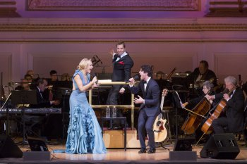 """Betsy Wolfe and Darren Criss with music director Steven Reineke at the podium as they appeared in The New York Pops presents """"42nd on 57th: Broadway Today"""" (Photo credit: Richard Termine)"""