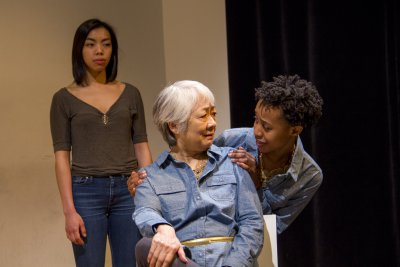 """Caitlin Cisco, Kitty Chen and Mirirai Sithole in a scene from """"The Hundred We Are"""" (Photo credit: Derek Van Heel)"""