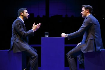 "Sanjit Da Silva and John Krasinski in a scene from ""Dry Powder"" (Photo credit: Joan Marcus)"