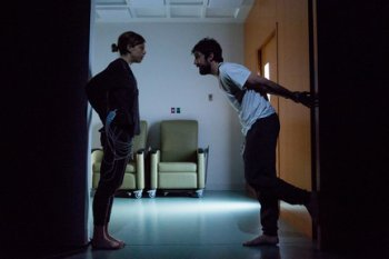 """Susannah Flood and Carter Hudson in a scene from """"The Effect"""" (Photo credit: Matthew Murphy)"""