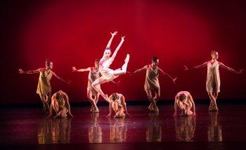 "Nathalia Arja and Miami City Ballet dancers in a scene from Alexei Ratmansky's ""Symphonic Dances"" (Photo credit: Sasha Iziliaev)"