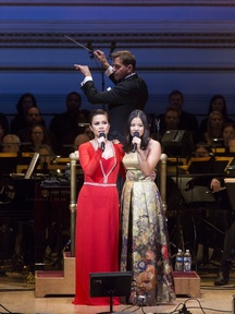 """Lea Solonga and Eva Noblezada, two """"Kims"""" from """"Miss Saigon,"""" with maestro Steven Reineke podium in The New York Pops' 33rd Birthday Gala entitled """" Do You Hear the People Sing"""" (Photo credit: Richard Termine)"""
