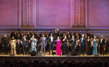 """Soloists and Essential Voice USA with music director Steven Reineke on the podium in The New York Pops's 33rd Birthday Gala entitled """" Do You Hear the People Sing"""" (Photo credit: Richard Termine)"""