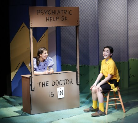 "Mavis Simpson-Ernst as Lucy and Joshua Colley as Charlie Brown in a scene from York Theatre Company's revival of ""You're a Good Man, Charlie Brown"" (Photo credit: Carol Rosegg)"