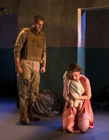 "Phil Feldman as Talthybius and Casey Wortmann as Andromache in a scene from ""The Trojan Women"" (Photo credit: Allison Stock)"