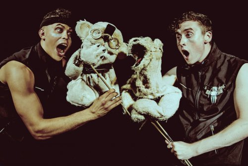 """Aaron Hefferman and Eoghan Quinn with puppets in a scene from """"Bears in Space"""" (Photo credit: Idil Sukan)"""