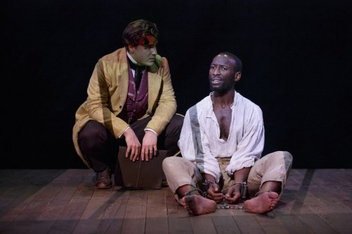 "Rowan Vickers and Philip James Brannon in a scene from ""Nat Turner in Jerusalem"" (Photo credit: Joan Marcus)"