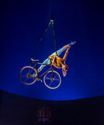 """France's Anne Weissbecker in the """"Aerial Bike"""" act in in Cirque du Soleil's """"Kurios: Cabinet of Curiosities"""" (Photo credit: Martin Girard/shoot studio.ca; costumes: Philippe Guillotel)"""