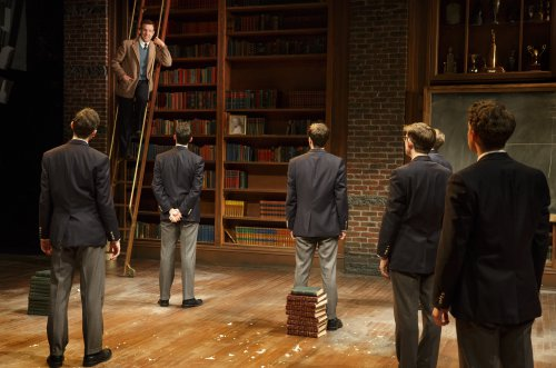 """Jason Sudeikis (on ladder) in a scene from """"Dead Poets Society"""" (Photo credit: Joan Marcus)"""