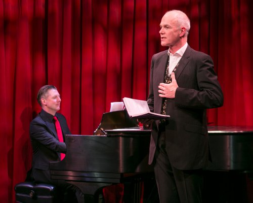 "David Shrubsole (on piano) and Simon Green in a scene from ""Life is for Living: Conversations with Coward"" (Photo credit: Heidi Bohenkamp)"