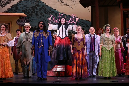 """Cáitlín Burke as Katisha and company in the first act finale of New York Gilbert & Sullivan Players' new production of """"The Mikado"""" (Photo credit: Carol Rosegg)"""