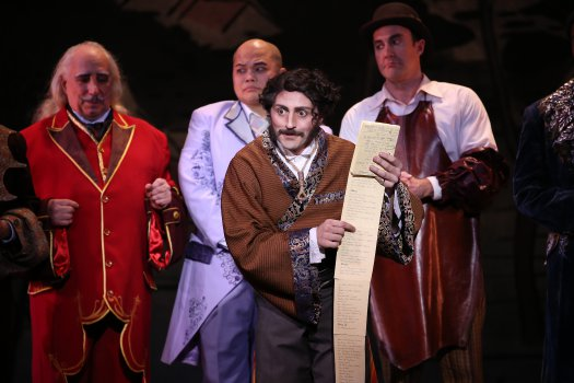 """David Macaluso as Ko-Ko with his little list in a scene from New York Gilbert & Sullivan Players' new production of """"The Mikado"""" (Photo credit: Carol Rosegg)"""