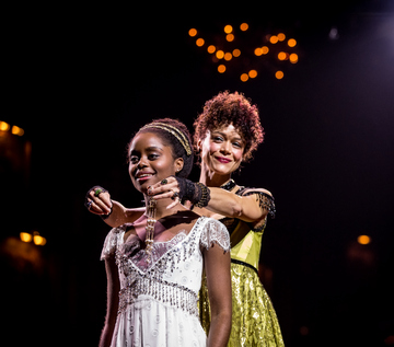 """Denée Benton and Amber Gray in a scene from """"Natasha, Pierre & The Great Comet of 1812"""" (Photo credit: Chad Batka)"""