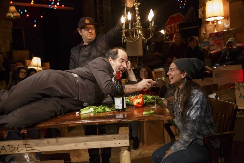 "Geoff Sobelle (on table) in a scene from ""The Object Lesson"" at New York Theatre Workshop (Photo credit: Joan Marcus)"
